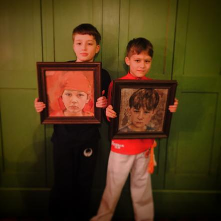 Happy boys with their portraits